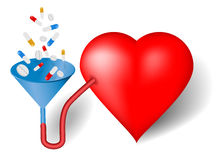 Röd hjärta och tratt, preventivpillerar Arkivbild