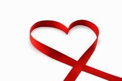 Röd hjärta som göras av ett band Arkivfoto