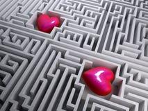 Röd hjärta två i labyrintlabyrinten Arkivbilder