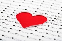 Röd hjärtaformbakgrund, förälskelsebefruktning Arkivfoto