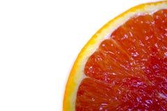 Röd huggen av apelsin på vit royaltyfri foto