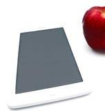 Röd isolerad äpple- och minnestavlaPC Arkivfoto