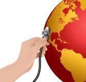 Röd jord med stetoskopet på en vitbakgrund Royaltyfri Illustrationer
