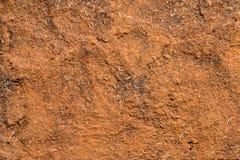Röd jordväggtextur royaltyfria bilder