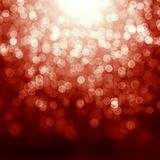 Röd julbakgrund med defocused lampor Arkivbild