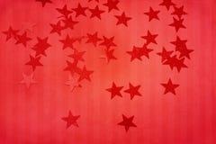 Röd julbakgrund med stjärnan fotografering för bildbyråer