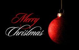Röd julboll på den svarta bakgrunden greeting lyckligt nytt år för 2007 kort arkivbilder