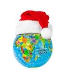 Röd julhatt för jordklot och Santa Claus Royaltyfri Foto
