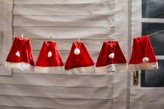röd julhattuttorkning Royaltyfri Foto