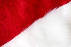 Röd jultomten och vit hattbakgrund Royaltyfri Fotografi