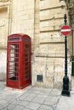 Röd kabin för brittisk telefon Fotografering för Bildbyråer