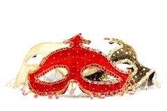 Röd karnevalmaskering framtill royaltyfria bilder