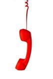 Röd klassisk telefonmottagare på vit bakgrund Royaltyfria Foton