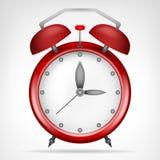 Röd klocka med objekt för rinnande tid Fotografering för Bildbyråer