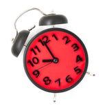 Röd klocka som pekar på 10 på vit Arkivbild