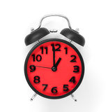Röd klockaframsida som pekar på 1:00 på vit Royaltyfri Bild