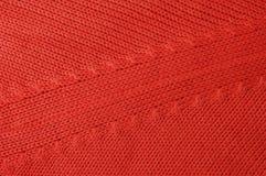 Röd knitwear Arkivfoto