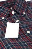 Röd kontrollerad modellskjorta Arkivbild