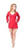 röd kort standing för klänningflicka Arkivfoto