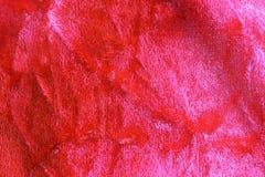 Röd krossad sammetbakgrund Arkivfoto