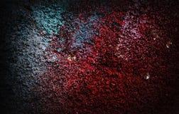 Röd kulör gammal stuckaturvägg för dramatisk grunge - grungebakgrund Arkivfoto