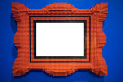 Röd kvarterbildram arkivfoto