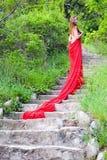 röd kvinna Arkivbild