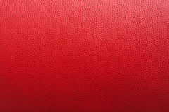 Röd läderbackgroung med grov yttersida Royaltyfri Fotografi