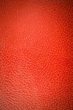 Röd läderbakgrund för tappning Arkivfoto