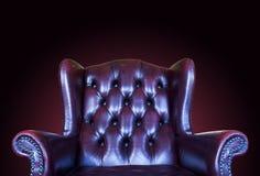 Röd läderstol för gammal tappning royaltyfri foto