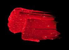 Röd läppstiftfläck Arkivbild