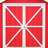 Röd ladugårddörr Arkivbild