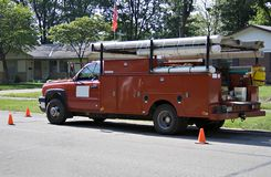 röd lastbilworking för uppsamling royaltyfria bilder