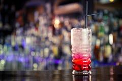 Röd lemonad på stången Arkivfoto