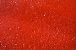 Röd målarfärg för textur Arkivfoton