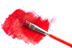 Röd målarfärg och borste royaltyfria bilder