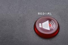 Röd makro för redialknapp arkivfoton