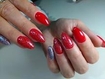 Röd manikyrdesign Royaltyfria Foton