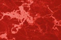 Röd marmortexturbakgrund med golvet för upplösning för detaljerad struktur det höga ljusa och lyxigt, abstrakta steni naturligt arkivfoto
