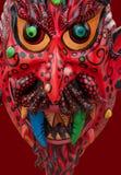 Röd maskering i Quito, Ecuador arkivbilder