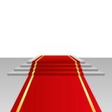 Röd matta och podium Arkivfoton