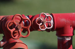Röd metallisk brandpost Arkivbild