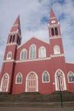 Röd metallisk kyrka Arkivfoton