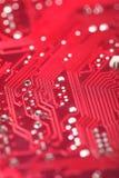 Röd microchip arkivfoto