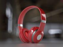 Röd modern hörlurar arkivbild