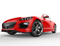 Röd modern racerbil på vit bakgrund - Front Wheel Closeup Royaltyfria Foton