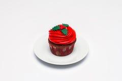 Röd muffin på en ljus bakgrund Arkivfoto