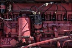 Röd närbild för traktormotor Arkivfoto