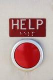 Röd nöd- knapp för HJÄLP med brailen Arkivbilder