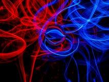 Röd och blå El-tråd mot en mörk bakgrund royaltyfria foton